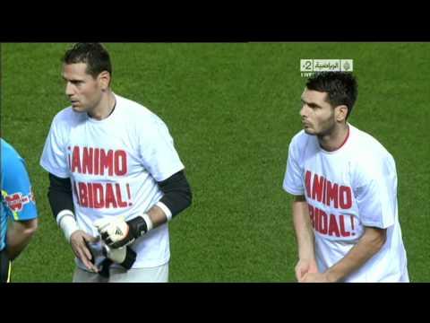 Barcelona and Sevilla players wearing Eric Abidal Shirts